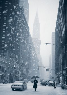 NYC. Snowy Lexington Avenue looking south with Chrysler Building in the background