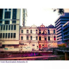 A vintage building surrounded by modern buildings, by Void Illuminated Artworks, Photo from the Instacanvas gallery of zhamlucan.