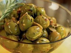 Marinated Spanish Olives - You can make and refrigerate this dish up to a week ahead; the flavors improve as the olives marinate. Use a mortar and pestle, meat mallet, or rolling pin to crush the coriander seeds and the rosemary. Tapas Recipes, Appetizer Recipes, Cooking Recipes, Antipasto Recipes, Tapas Ideas, Fingers Food, Low Sugar Snacks, Spanish Olives, Spanish Dishes