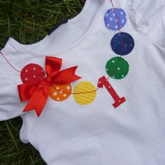 "Birthday Necklace Shirt...cute idea for the birthday girl...could also be done for the birthday boy using football shaped ""little boy"" fabric and leaving out the bow and ""necklace stitching""...Meredith Robinson, I though of you on this one as something for Lauren with all your crafty sewing ideas!"