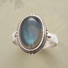 TWILIGHT RING -- Ambient light is caught in a labroradite cabochon surrounded by a patterned sterling silver bezel. Whole and half sizes 5 to 9.