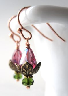 Tiny Sleeping Lotus Flower Earrings - Petite Water Lily Blossom Pink Crystal Earrings - Gift for Yoga Yogini, Koi Pond Lover, Nature Lover. $28.00, via Etsy.