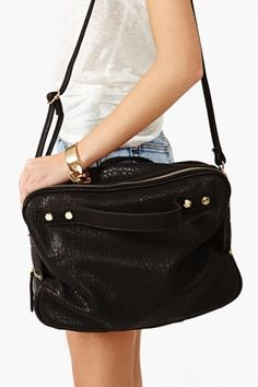 This simple black bag goes with anything and can hold anything.