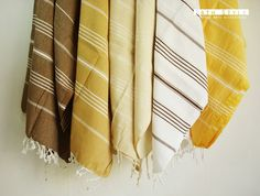 Turkish towels - as absorbant as a regular towel but dries faster and takes up a lot less space in the closet.