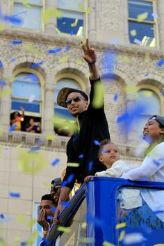 . Stephen Curry and his family reacts to the roar of the crowd along the parade route along Broadway in Oakland, Calif., on Friday, June 19, 2015.  (Laura A. Oda/Bay Area News Group)