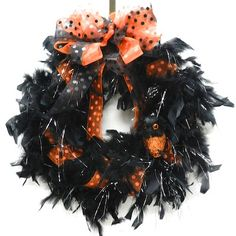 Halloween wreaths are a great way to decorate your home and show your spooky and fun spirit. Using black and silver craft feather boa create an easy to make Halloween Wreath.