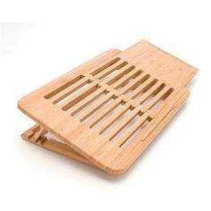 """Lipper's Bamboo Expandable Laptop Stand is ergonomically designed. The expandable feature (from 15-3/8"""""""" to 20-5/8"""""""" Wide) conveniently allows for a mouse, notepad, or other office material you need."""
