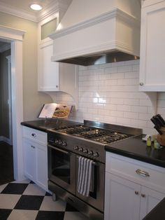 white cabinets + black countertops + white subway tile = Our future kitchen.