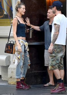The couple who coordinates... Behati Prinsloo and her husband Adam Levine sported matching...