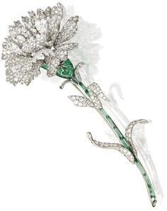 White carnation brooch by Michele della Valle, set with white diamonds in white gold and titanium. The lovely green stem is detailed in cabochon green tourmaline segments.