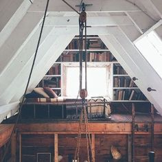 A cozy reading nook in a rustic attic library