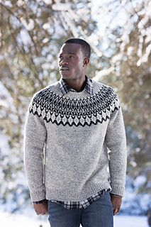 This Icelandic-inspired design, refined with a more tailored fit, is equally fetching on men or women. The striking graphic sunburst yoke, which requires the use of three colors on some rounds, looks handsome in almost any combination of light, medium, and dark hues from the Shelter palette; the masculine sample uses a marl as the middle value to add further depth to the graphic motif. The neckline is slightly wider than traditional to allow for comfortable layering.