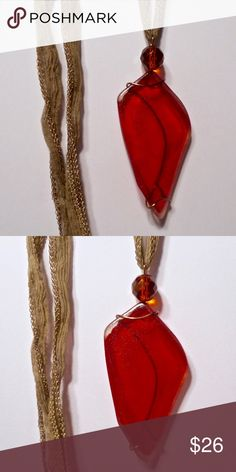 "red vintage glass art pendant necklace Rich red vintage glass, with clear glass, wrapped in bronze plated wire. sitting atop is a large, faceted orange glass bead. very eye catching! Measures 3""h x 1 1/2""w. 32"" fairy silk ribbon klinsky Jewelry Necklaces"