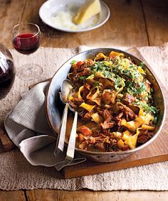 The rich boar ragu is complemented by a zesty lemon pangrattato in this slow-cooked recipe.