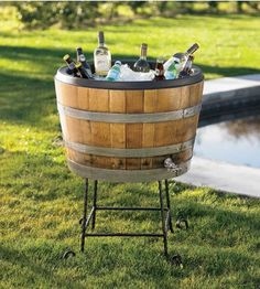 Wine barrel - has a liner in it. If it's food grade it could be good for sangria or gazpacho. Might have to make a couple of these for summer activities