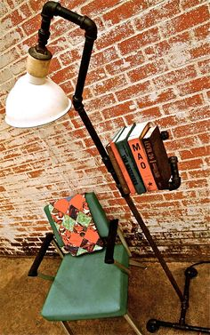 Floor lamp bookshelf from industrial pipe and old aluminum shade.  I will NEVER fall out of love with this...