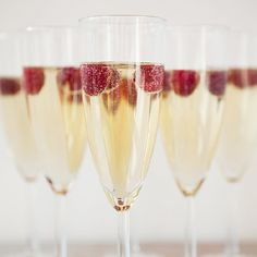Looking for the perfect way to embellish your wedding toast... how about with some raspberry liqueur and fresh berries ~ delicious + cute!