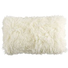 "Faux but on sale $20.- 12 x 20"" pier one. Super-fluffy and fun-furry, the front of this oh-so-soft pillow instantly invites you to get comfortable. And on the reverse? A velvety, plush finish. Either way, it's a cool addition to your sofa or bed."