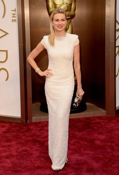 Brides.com: The Best Dresses at the 2014 Oscars. Naomi Watts in Calvin Klein. Does Naomi ever disappoint? This glimmering white column gown makes us think the answer is no. Ever the sartorial risk taker, she added a geometric silver necklace to the high-necked gown, and pulled it off perfectly. We love the look for a modern, downtown wedding.  See more high-necked dresses.