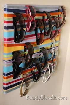 Where to put all my sun glasses? DIY sun glass holder - canvas and ribbon. Functional Art!