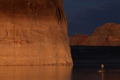 Week of Mar 28 - Apr 3, 2015 A paddleboarder floats by Lone Rock on Lake Powell near Big Water, Utah. Amid a severe drought in parts of the Western U.S., Lake Powell is at about 45% capacity. JUSTIN SULLIVAN/GETTY IMAGES