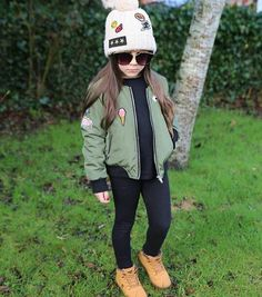 This is definitely going to be my daughter some day! I love this whole outfit!   Bomber jacket, logo beanie, black leggings and boots!