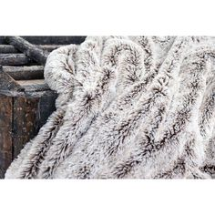This super luxe faux fur blanket will add a cozy touch to your home with its ultra-soft fabric. Add texture to your decor and turn your room into an inviting space. The neutral light grey with subtle