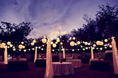 Outside. LOVE this idea with the tables, lanterns and lights