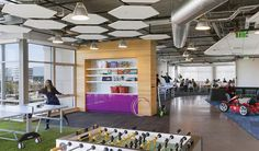 DES Architects + Engineers designed the offices of the world's largest domain name provider GoDaddy in Sunnyvale, California. The free-flowing space is connected by racetrack-themed corridors — complete with push-pedal ... Read More
