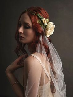 Eloise is a earthy and delicate crown with weaving vines and a flowing cascade veil. The circlet base is decorated with a cream cabbage rose and small wild roses. Velvety leaves, ferns, and vines are interwoven throughout for a more natural look. -- full circlet crown -- cathedral length veil (available in different lengths/colors) -- fits 22 heads (can be made to your measurement per request) -- handmade with ♡ by me -- leaves my studio in 1-2 weeks  shop www.gardensofwhimsy.com | socia...