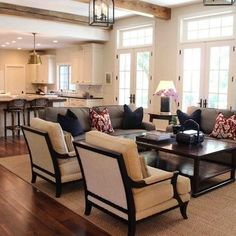 Rug, colors, beams, french doors, transom windows, wall of windows, furniture arrangement with open floor plan | In love with home decoration