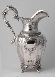 Ornate silver pitcher