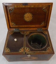"""Interior view of excellent 19th c. mahogany tea caddy with single interior tea compartment and glass sugar bowl. Beautiful exterior and interior floral and fan inlay of contrasting woods and cross-banded edges. In very good overall condition with some wear from age and use, as shown. Dimensions: 4-1/2""""H x 7-5/8""""L x 4-3/4""""D. New Hampshire Antique Co-op Inc./Ruby Lane"""