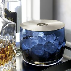 Shop Orb Sapphire Blue Ice Bucket.  Part of our seriously stylish Orb mixology collection, this stunning blue glass ice bucket pairs a deep cased glass bowl with a sleek, brushed stainless-steel lid.