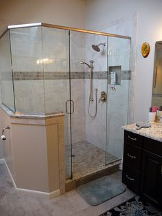 Bathroom remodel, removable shower head, tile shower floor, rain shower head, mosaic tile accent in shower, glass all around shower