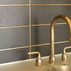 You can also use metal inlays for high-design look and feel. Bringing metallic i… You can also use metal inlays for high-design look and feel. Bringing metallic into your tile work adds shine and polished mixed-media approach. Tile Trends, House Tiles, Metal Tile, Bathroom Trends, Bathroom Design Trends, Main Bathroom Designs, Gold Tile, Flooring Trends, Tile Bathroom