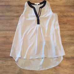Grey and black sleeveless blouse Grey and black sleeveless blouse Monteau Tops Blouses