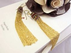 Luxurious long tassels... almost touches your shoulder! > $40 > http://www.etsy.com/listing/86449518/mongolian-tassels-chain-earrings-red #fashion #earrings #tassels #shoulder_dusters #gold_chain #chains #mongolian #red #bronze #beaded_earrings #valentines #gift #women #handmade