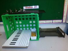 This teacher has 5 music stations spread around the room. Each has music writing…