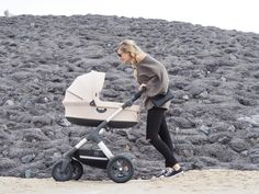 A higher positioned Carry Cot seat lifts baby closer to you while strolling.... All Terrain Stokke Trailz Stroller in Beige Melange fabric