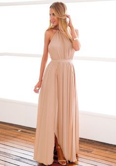 Rock on this nude M-slit halter dress with ankle strap heels for a striking appearance to any formal event you've got invited with.