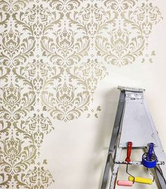 DIY painted and stenciled classical accent wall ideas on a budget using easy to use damask stencil patterns from Cutting Edge Stencils instead of pricey wallpaper