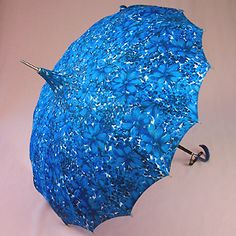 This gorgeous blue umbrella would make a rainy day a treat!