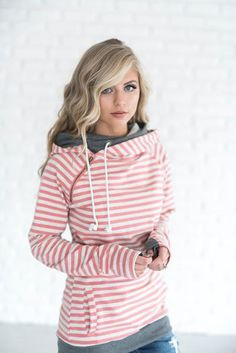 This adorable double hooded sweatshirt is the perfect lightweight hoodie to add to your closet. Featuring a diagonal zipper, and double hood, contrasting fabrics, it's perfect for the fashion savvy girl that needs to be comfortable.