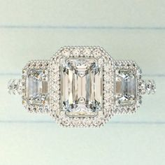 Would you wear this stunningly gorgeous emerald cut diamond engagement ring? ❤
