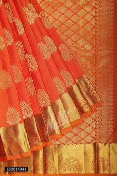 Orange Kanchipuram Silk Saree with Zari butta on body and Zari border.