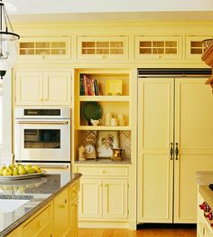 I love the use of the top section of cabinets....beautiful way not to waste that space!