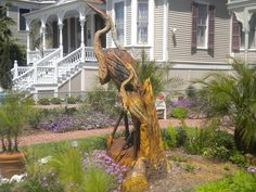 100 year old oak that dies in hurricane Ike, is carved into a Blue Heron