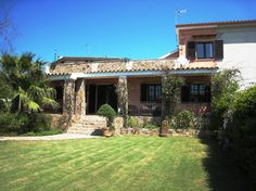 CHARMING HOLIDAY HOME WITH LARGE GARDEN AND PRIVATE ORCHARD - VILLA GRAZIA is a…