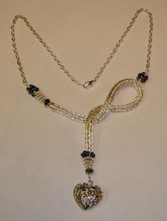 Viking Knit Heart Necklace with Twist and Coil Design